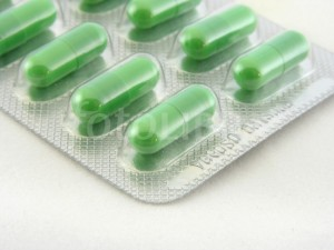 Green capsules in blister pack